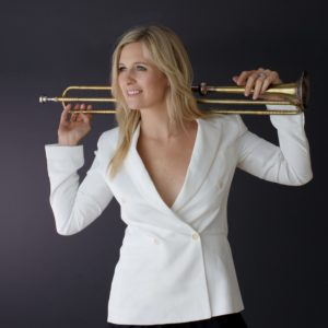 Celebrated trumpeter Alison Balsom with trumpet held across her shoulders