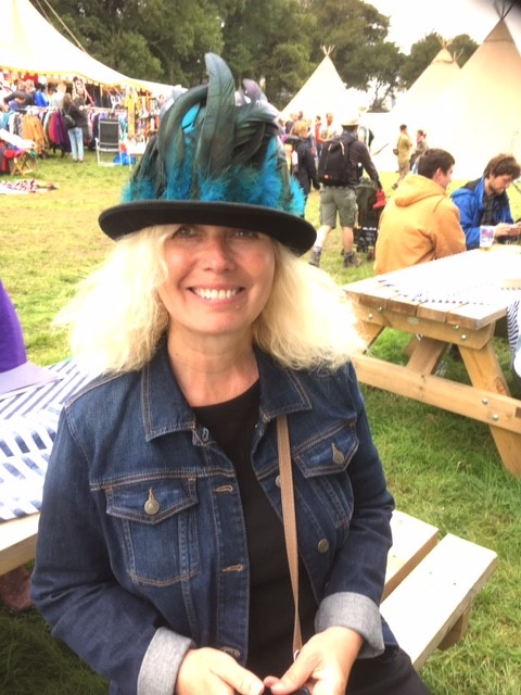 Karin Andre at a festival with hat